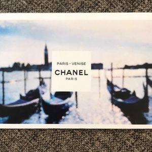 3 Chanel postcards.